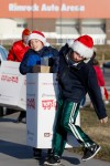 Evan and AJ Makoff carry a box of donations