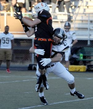 West's Cody McCombs tackles _ mid-air