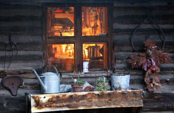Light from kerosene lamps shows through the window