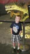 Jaden Wagner, 6, poses with a dinosaur