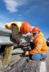 Brandon Cain and Rob Tinch repair a guard rail on the Beartooh H