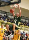 Joel Barndt of Rocky Mountain College dunks the ball