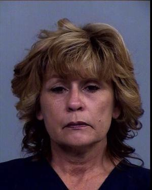 Sheriff's deputies arrest woman suspected of stealing more than 250 vases from cemetery