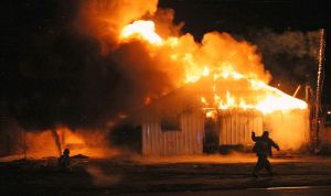 Fire burns auto auction building on South Side