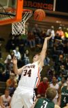 Maclean Turner of Senior scores from under the basket