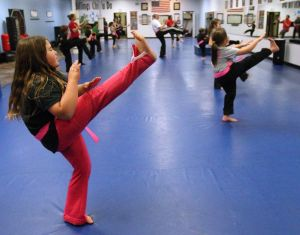 'You're a fighter. And you're strong': Pink belts help students fight cancer 1 kick at a time