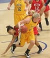 MSUB's Kaylee Goggins, 43, drives with the ball as Dixi State's Erica Hayes, 24, defends