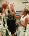 Kayleen Goggins drives between Rocky defenders