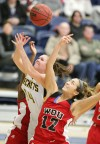 Annie DePuydt reaches for a rebound
