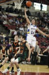 Mike Vohs of Melstone drives to the basket