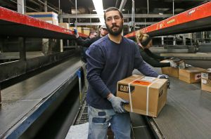Boxed in: Online shopping increase puts holiday crunch on package companies to fill job openings