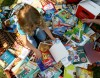 Eleni Michaelides looks through a pile of books