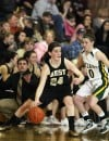 Brianna Robinson of Billings West dribbles away from Brandy Kumm of Great Falls CMR