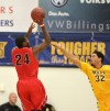 Omar McDade of Montana State Billings defends a shot