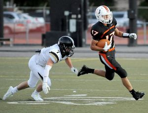 West's Jackson Cobb pursues Senior's Nolan Timmons