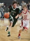 Jacob Stanton of Central pushes the ball up the floor