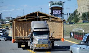 Habitat home rolls to its permanent location in Heights