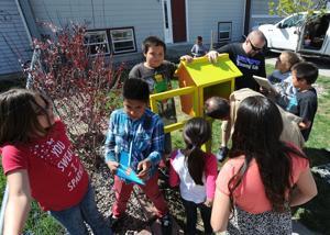 Neighborhood children help set up their own lending library