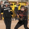Katie Zink of West reaches first base