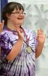 Aspyn Schnetter celebrates her gymnastics medal