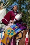 A tribe member rides in the Saturday morning Crow Fair Parade