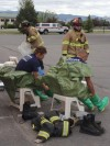 Crews in plastic suits tape their legs.
