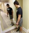 Koni Dole views his prosthetic leg