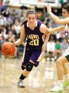 Allie McGrath of Laurel (20) pushes the ball up the floor against Allie Lucas
