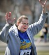 Special Olympian Heidi Martin rejoices after competing in the soft ball throw