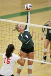 Kristin Barott of Rocky Mountain College tips a ball over the net