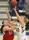 MSUB's Kaylee Goggins, 43, puts up a shot as Moorhead's Megan Strese, 50, defends