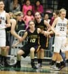 Laurel's Dalayna Christenson, left, and Allie McGrath, right, help Jayde LeFevre up