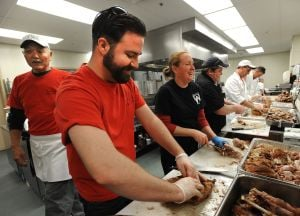 Volunteer cooks fill kitchen at Food Bank for Thanksgiving prep