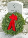 A Christmas wreath on a veteran's grave