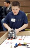 Brendan McGovern lines up his robot