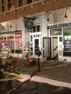 Firefighters respond to a small fire at the Acme Building