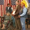 Sen. Jon Tester receives a picture of Micah Highwalking