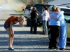 Grief stricken owners arrive at the scene of a horse barn fire