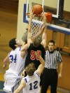 Danny Little of Billings Skyview defends a dunk