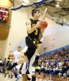 Christian Kappel of West flies into the lane