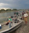 Members of the Yellowstone River Conservation District Council board jet boats