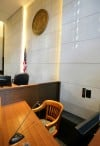 The witness stand is seen inside the Big Horn Courtroom