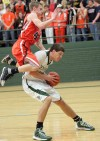 Central's Daniel Meyer, 32, is fouled by Senior's Brennan Nielsen, 44,