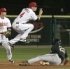 Billings Mustangs' Zach Vincej, 4, jumps over Missoula's Breland Almadova, 21