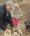 Quinn Thurston and her Dad Geoff plant willows
