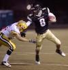 West's Ryan Gallogly, 8, runs the ball as CMR's Jake Horton, 13, defends