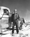 Neil McMurry stands next to his business pickup