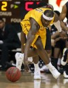 Wyoming forward Leonard Washington goes after a loose ball