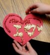 Kindergartners make paper hearts