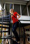 Eileen Ziler climbs the spiral staircase